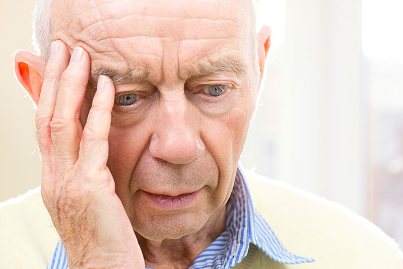 Senior Man Holding Head