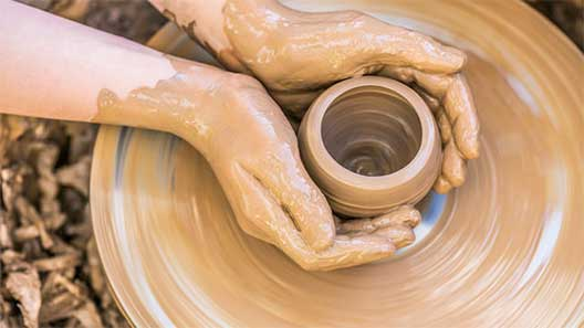Hands Using Pottery Wheel