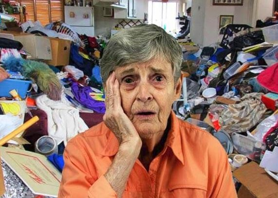 woman overwhelmed in clutter